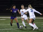 Columbia RiverÕs Yaneisy Rodriguez (10) fights for the ball against RidgefieldÕs Claire Jones (11) during the 2A district championship at Columbia River High School in Vancouver on Nov. 7, 2019. Ridgefield won 2-1.