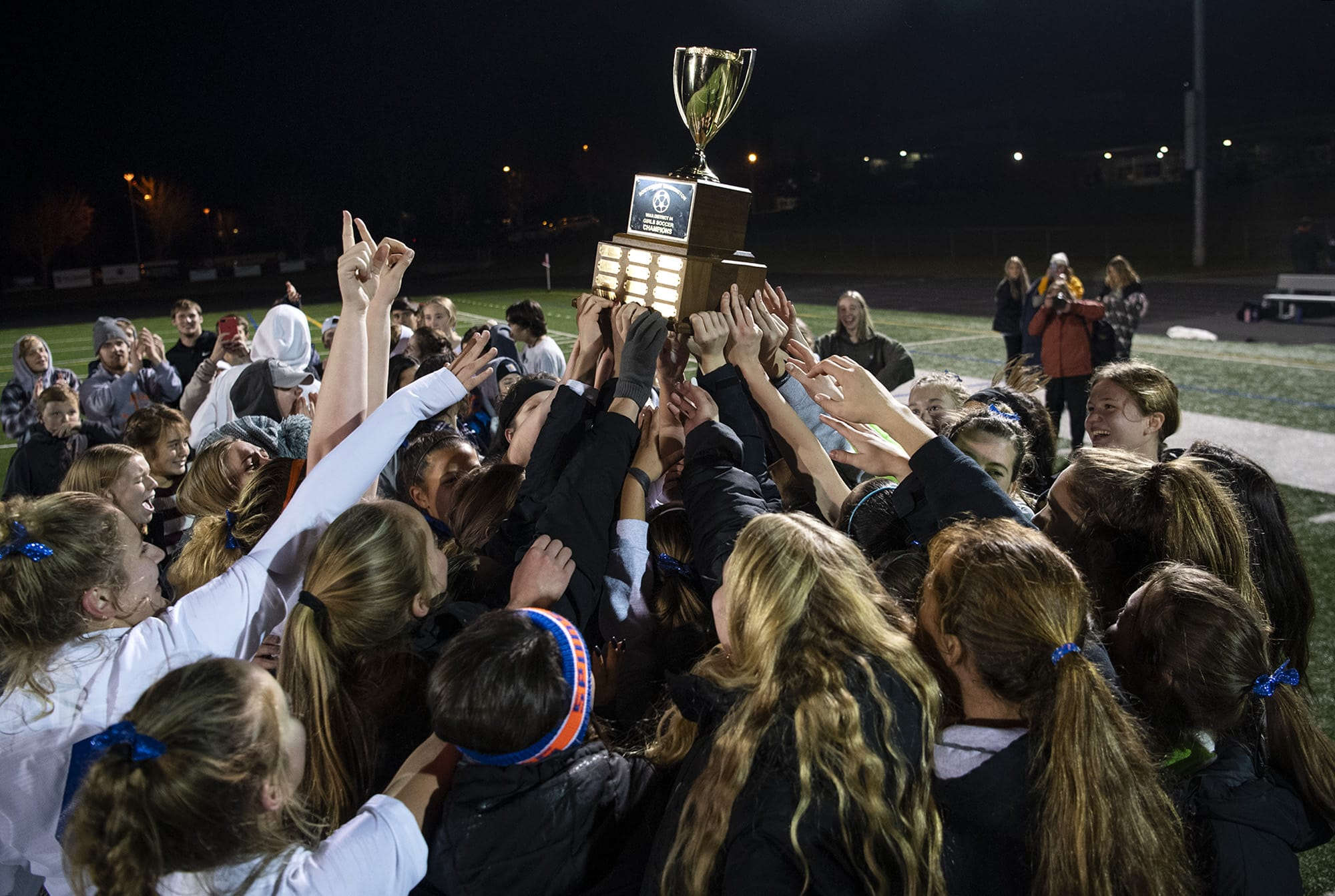 Ridgefield celebrates their 2A district championship win against Columbia River at Columbia River High School in Vancouver Nov. 7, 2019. Ridgefield won 2-1.  (Alisha Jucevic/The Columbian)