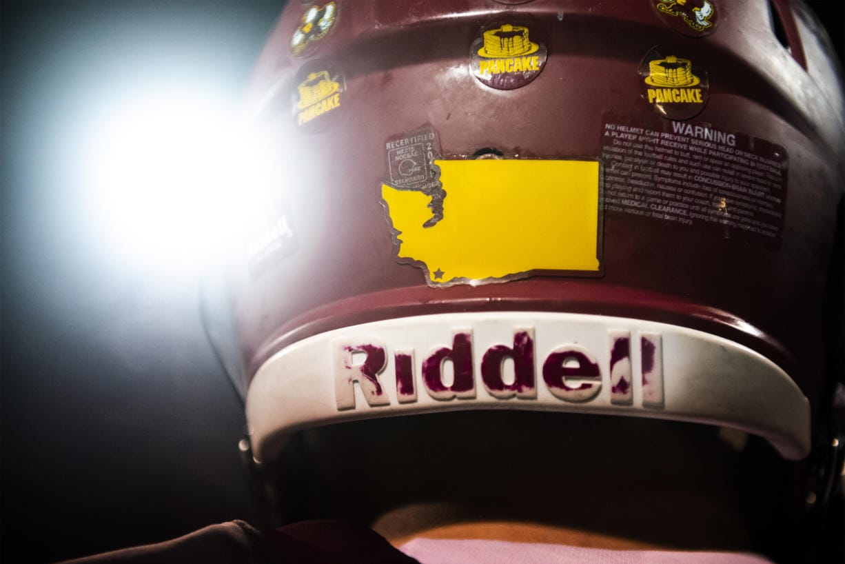 A map of Washington showing the location of Prairie High School is seen here on the back of a player's helmet.