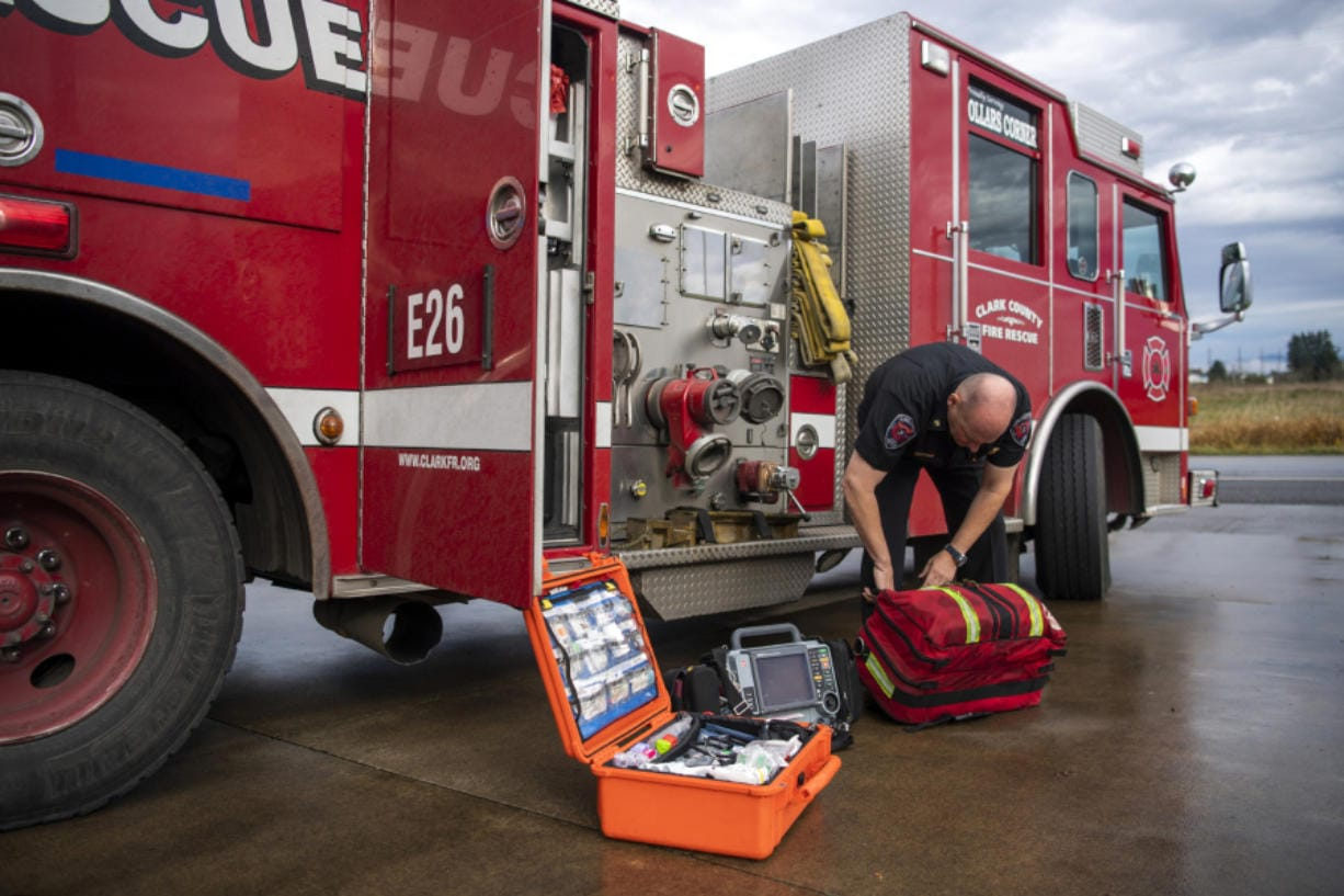 Clark County Fire & Rescue Chief John Nohr describes the emergency medical equipment stored on the fire engines at Fire Station 21 in Ridgefield. (Alisha Jucevic/The Columbian)