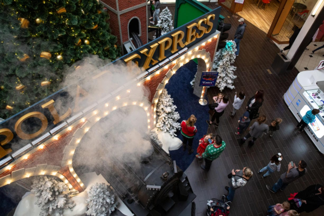 "Visitors wait in line at ""The Polar Express"" set to meet Santa Claus at Vancouver Mall. The set debuted this year and is more than twice the size of the mall's previous Santa display."