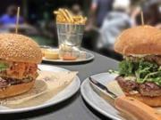 Big Kahuna, left, and Truffle Mushroom burgers at Stack 571.