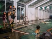 Westley Mejias greets his kids Diana, 4, Sarah, 6, and Manuel, 2, as he coaches at the Lacamas Athletic Club. The kids all take swimming lessons at the club, and Westley?s wife, Juana Santana, is on the masters swimming team. Mejias and his family moved to Camas after Hurricane Maria devastated Puerto Rico, where he coached swimming for a national team and the University of Puerto Rico.