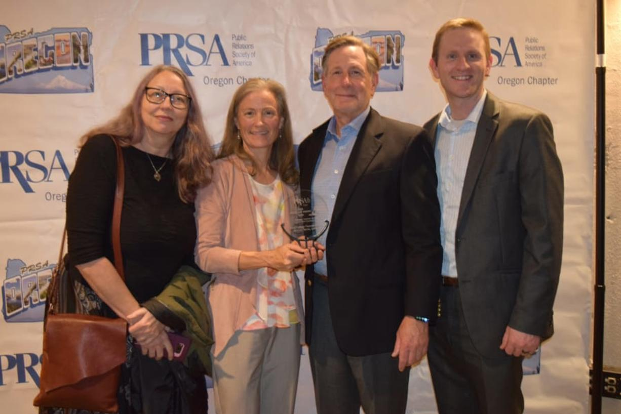 CENTRAL PARK: Clark College Foundation's Kathy Chennault, from left, Rhonda Morin, Eric Merrill, and Daniel Rogers accept the 2019 Spotlight Award from the Oregon chapter of the Public Relations Society of America. They received the award for work on their Penguin Chats podcast.