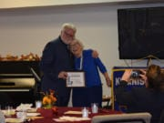 ORCHARDS: Dan Murphy of the Broadway Rose Theater and Vivian Peterson, a member of Cascade Park Kiwanis, celebrate Murphy's Distinguished Service Award at the Cascade Park Kiwanis 11th Annual Fall Festival of Service.
