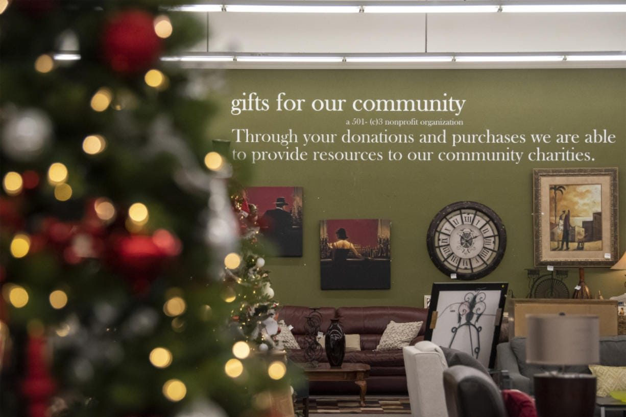 "Vancouver's Divine Consign ""gifts for our community"" motto is seen here with Christmas trees that will be raffled at the store during the holidays."