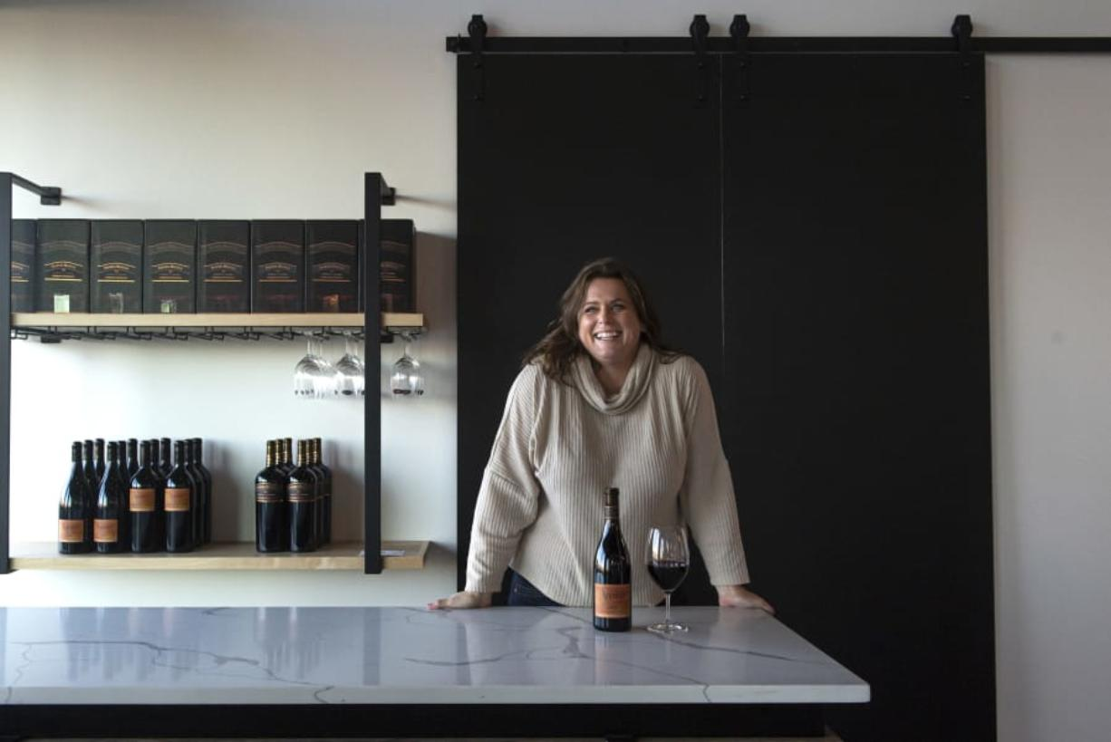 Heidi Griggs is the manager of the joint Pepper Bridge Winery and Amavi Cellars tasting room. The new tasting room seats 44, plus seasonal patio seating. (Nathan Howard/The Columbian)