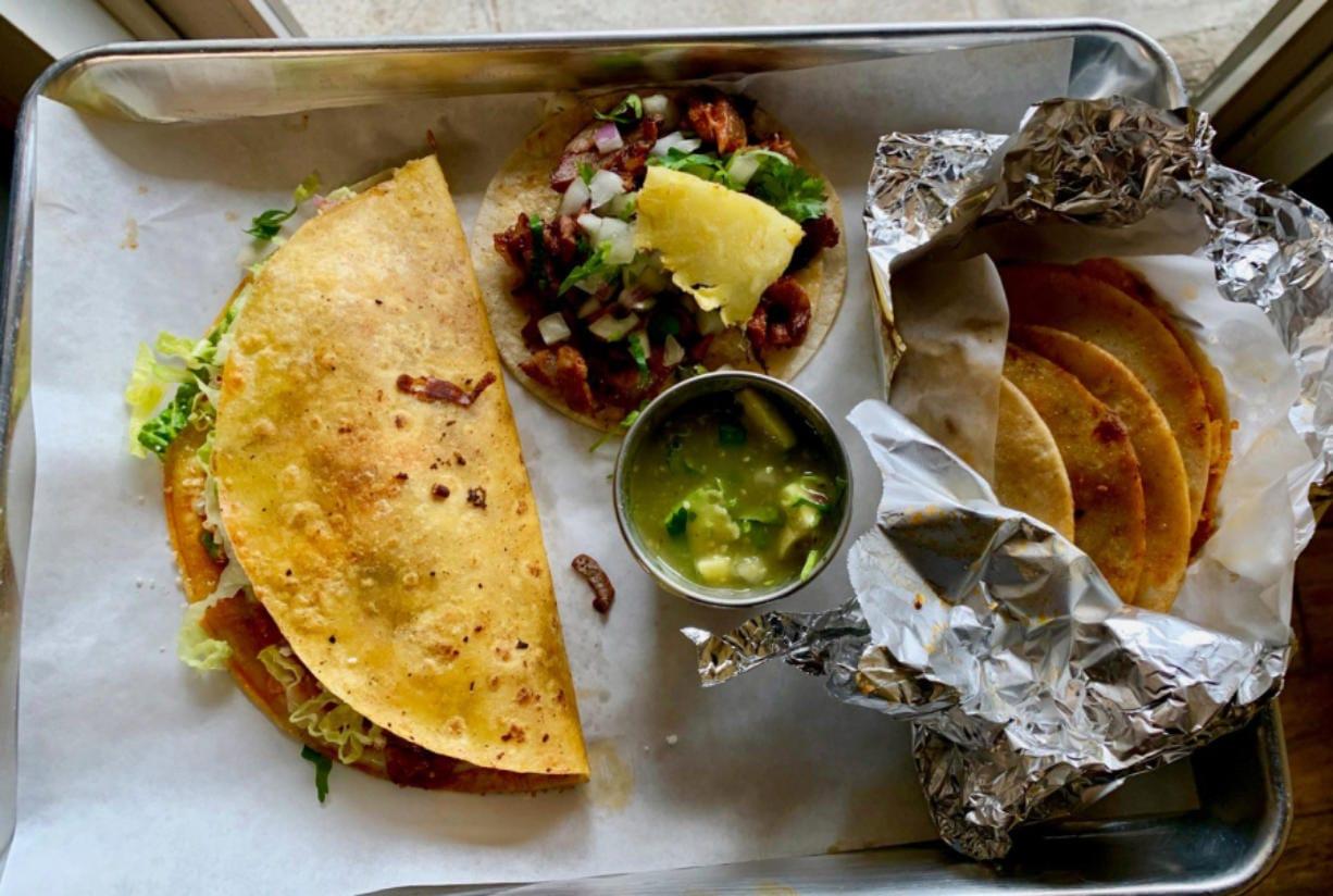 A keka, taco al pastor and basket tacos at Los Alambres. (Rachel Pinsky for The Columbian)