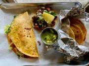 A keka, taco al pastor and basket tacos at Los Alambres.