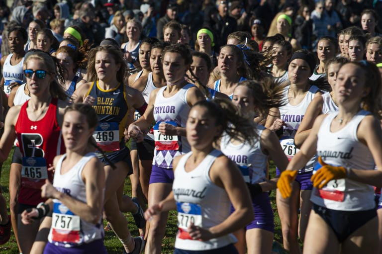 Runners break away from the starting line of the women's 5 kilometer race during the NAIA Cross Country National Championships on Friday morning, Nov. 22, 2019.  (Nathan Howard/The Columbian)