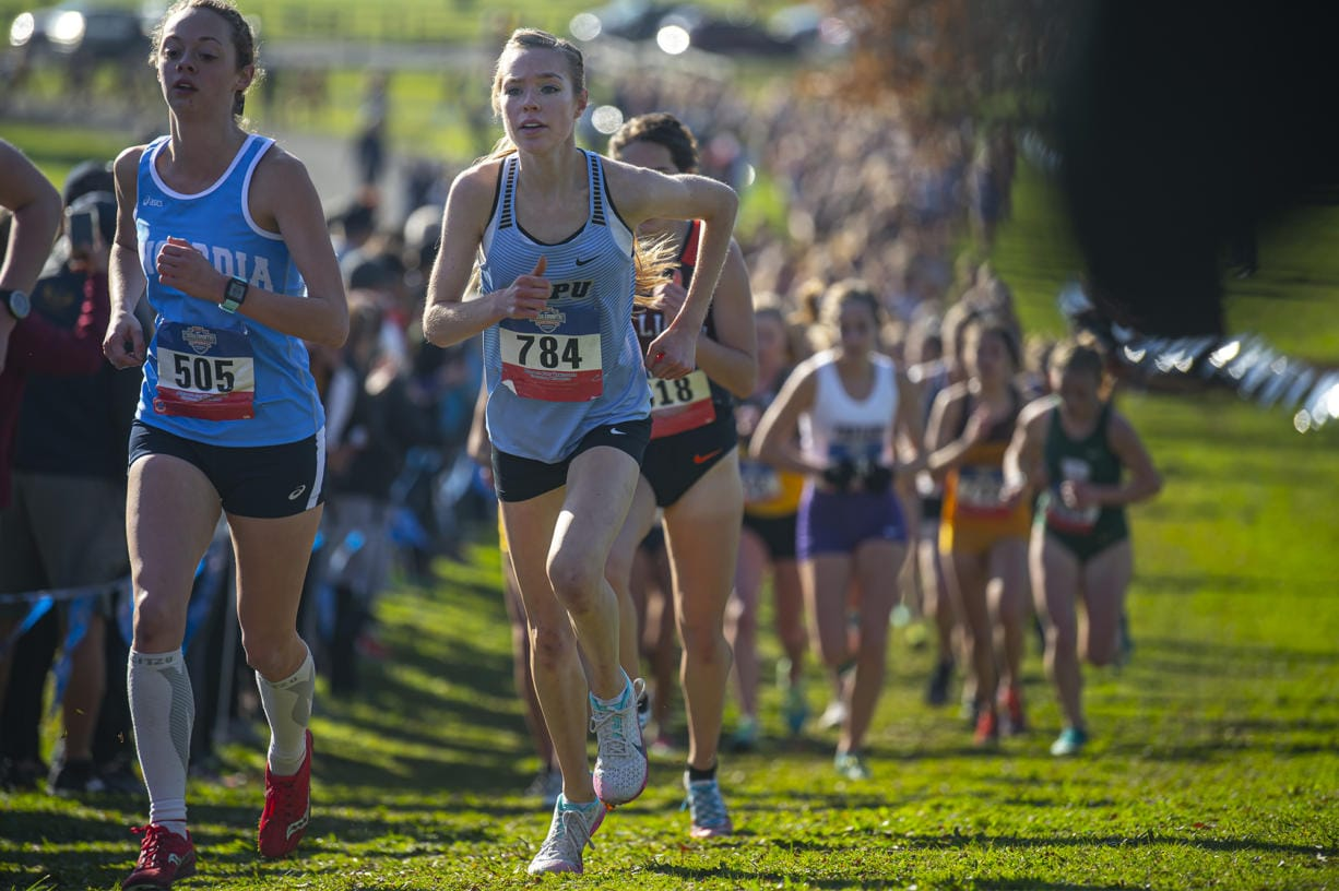 Warner Pacific's Amelia Pullen, right, competes in the women's 5 kilometer race during the NAIA Cross Country National Championships on Friday morning, Nov. 22, 2019.
