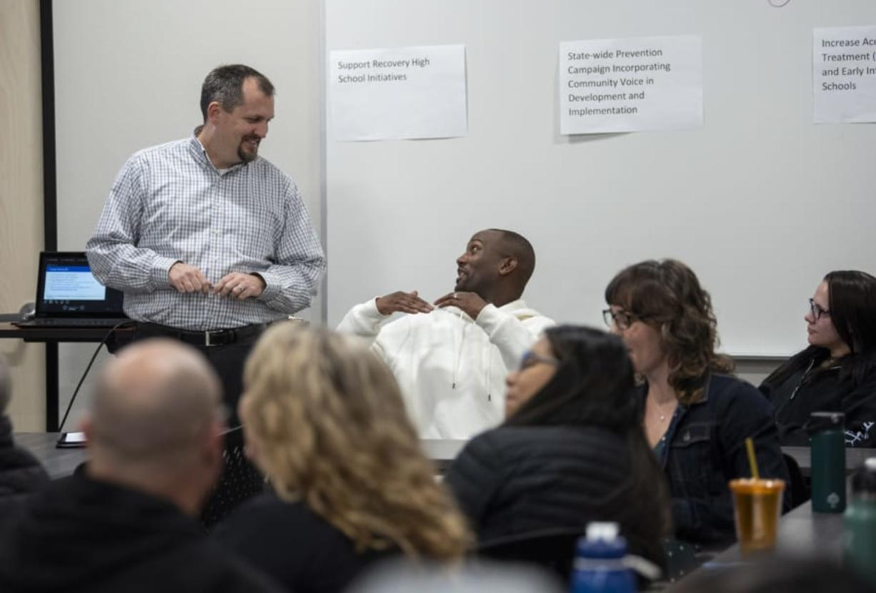 Jim Jensen, a manager of collaboration and learning with Southwest Washington Accountable Community of Health, left, talks with Randall Brewster during an Opioid Task Force meeting at Bridgeview Resource Center in Vancouver. Jensen is the task force facilitator.