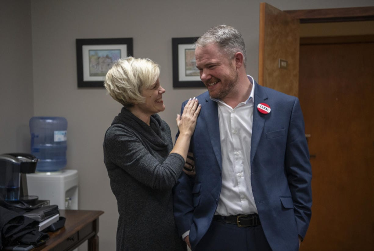 Anastasia McDonnell congratulates her husband, Barry McDonnell, after he was sworn in Tuesday as the mayor of Camas.