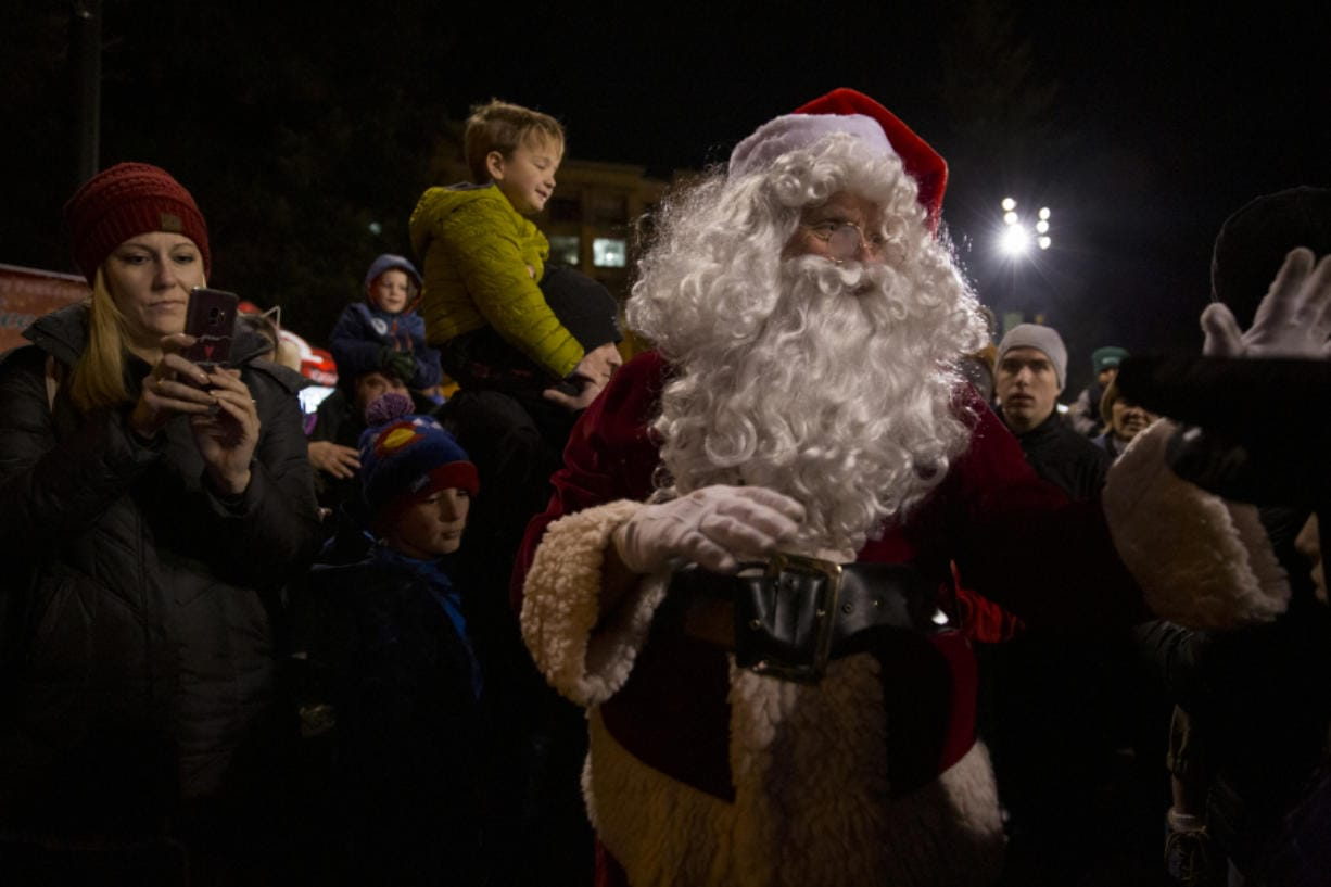 The star of Friday night's tree lighting, Santa, arrived on a Vancouver Fire Department fire engine and walked through a crowd of thousands to officially light Vancouver's Christmas tree and welcome in the holiday season.