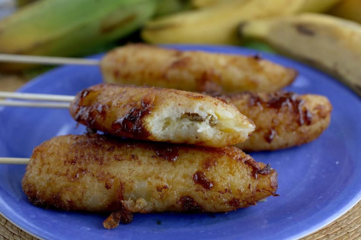 Fried banana with brown sugar, on a stick. (Hillary Levin/St. Louis Post-Dispatch/TNS)