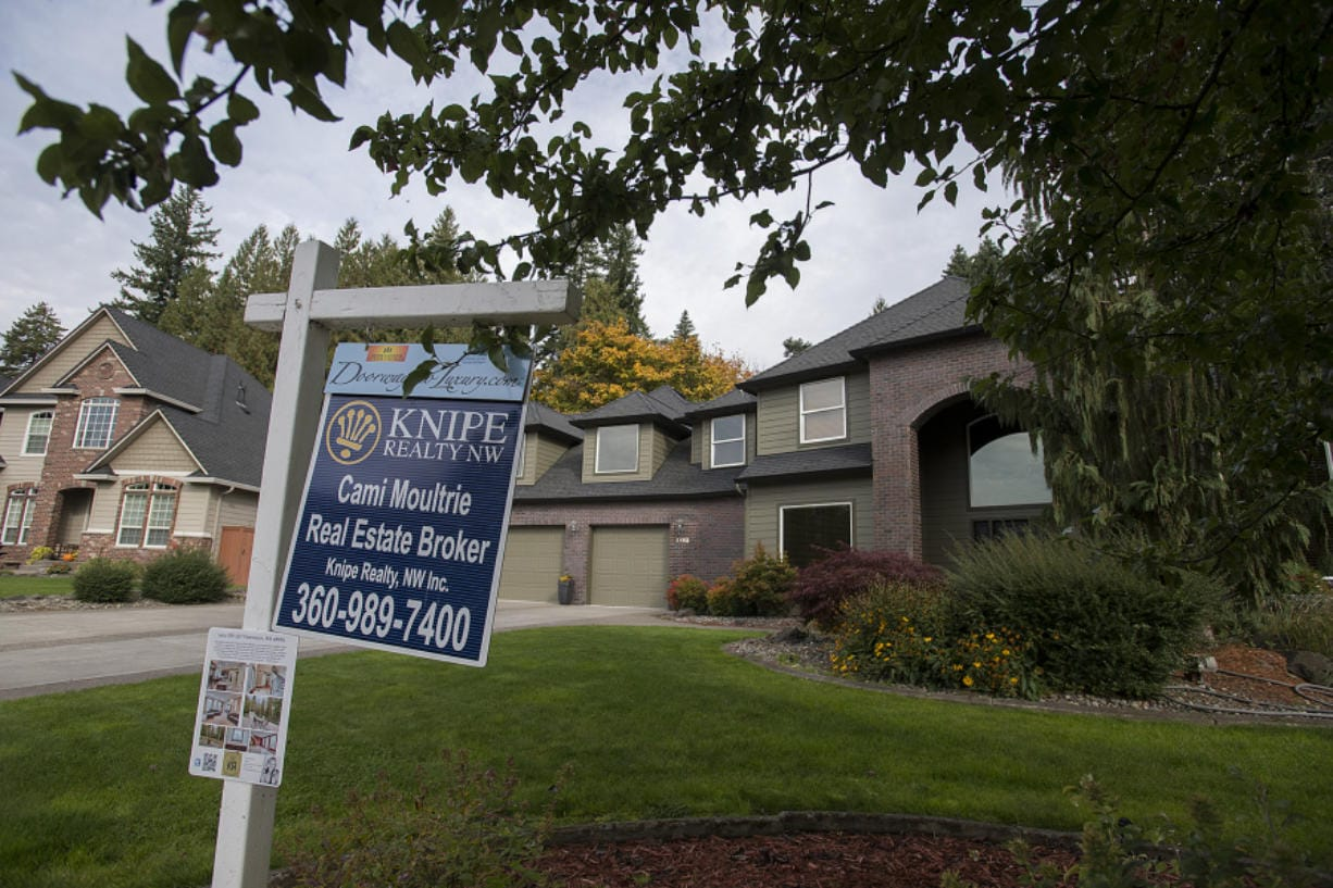 A real estate sign is posted outside a Salmon Creek home for sale on Oct. 15. (Amanda Cowan/The Columbian)