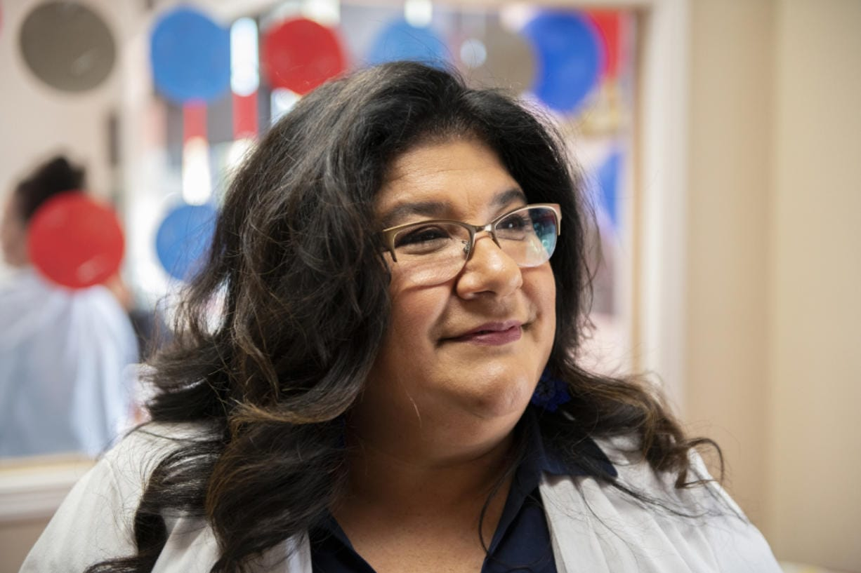 Diana Perez, a member of the new Task Force on Council Representation, attends a meet-and-greet hosted by two business owners on July 30.