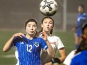 Mountain View's Ellie White (12) tries to bring down a ball while fending off Lakes' Aly Bryan in a 3A bi-district girls soccer game Tuesday at McKenzie Stadium.