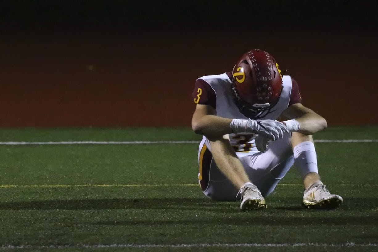 Prairie's Ian Davis sits dejected Friday evening at Quil Ceda Stadium in Marysville on November 15, 2019. Marysville-Pilchuck won 37-30 in overtime.