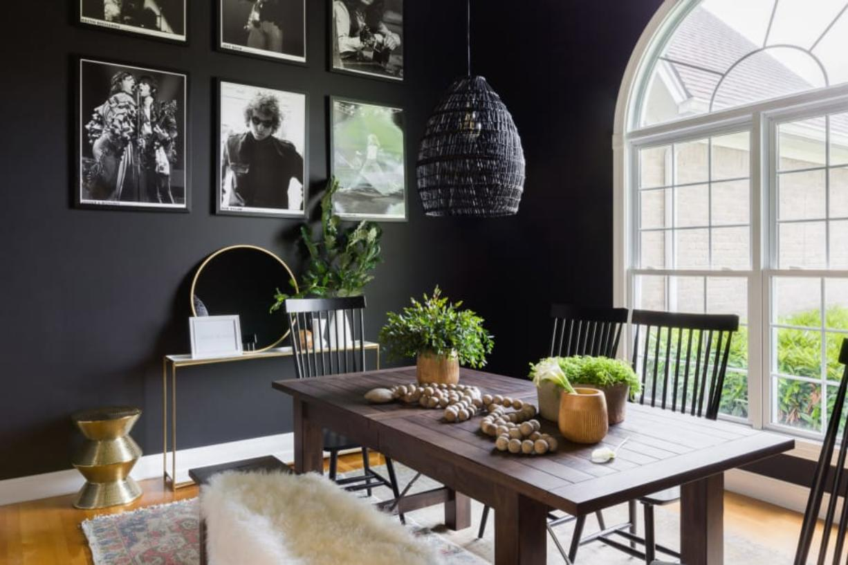 """Whether sleek and modern or rustic farmhouse, black paint and decor offers a sophisticated air to many different looks,"" says Briana Nix, who designed this black dining space. (Alyssa Rosenheck)"
