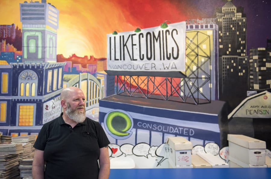 Chris Simons, owner of I Like Comics, is pictured at the shop in downtown Vancouver on Jan. 22. (Alisha Jucevic/The Columbian)