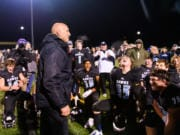 Hockinson Coach Rick Steele tells the team how proud he is of them as they celebrate their 29-28 win over Lakewood in a quarterfinal game on Saturday, Nov. 23, 2019, at Battle Ground District Stadium. (Molly J.