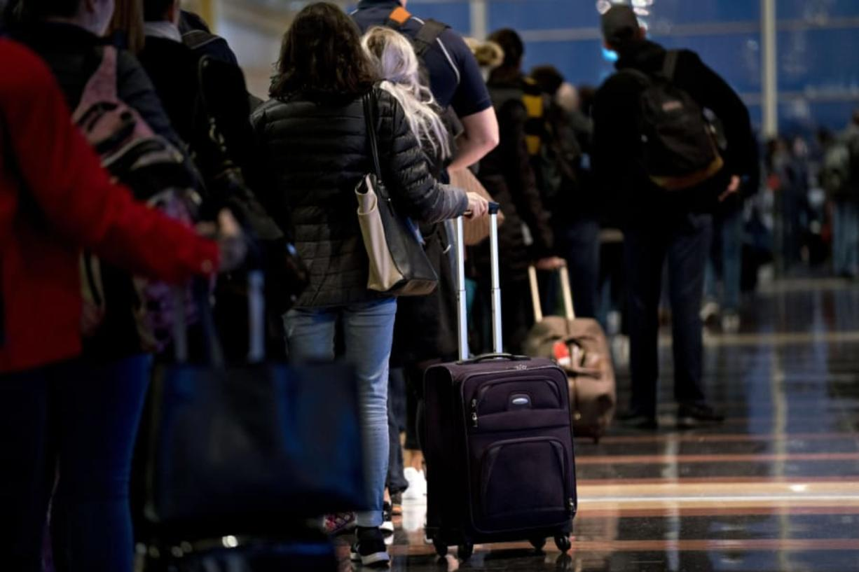 Travelers wait in line Nov. 21, 2018, before going through Transportation Security Administration screening at Ronald Reagan National Airport in Washington. (Andrew Harrer/Bloomberg)