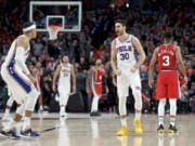 Philadelphia 76ers guard Furkan Korkmaz, right, reacts after making the game winning basket against the Portland Trail Blazers during the second half of an NBA basketball game in Portland, Ore., Saturday, Nov. 2, 2019. The 76ers won 129-128.