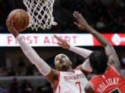 Carmelo Anthony (7) is returning to the NBA with the Portland Trail Blazers. The 10-time All-Star has not played since a short stint with the Rockets ended a little more than a year ago after just 10 games. (AP Photo/Nam Y.