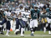 Seattle Seahawks' Rashaad Penny (20) runs for a touchdown during the second half of an NFL football game against the Philadelphia Eagles, Sunday, Nov. 24, 2019, in Philadelphia.