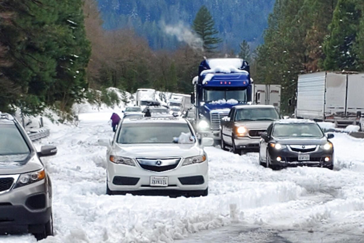 In this photo provided by Caltrans, are cars and trucks in stopped traffic on Interstate 5 near Dunsmuir, Calif., Wednesday, Nov. 27, 2019. Thanksgiving travel has been snarled in some places by two powerful storms. A winter storm blamed for one death and hundreds of canceled flights in the West moved into the Midwest on Wednesday and dropped close to a foot of snow in parts of Minnesota and Wisconsin.