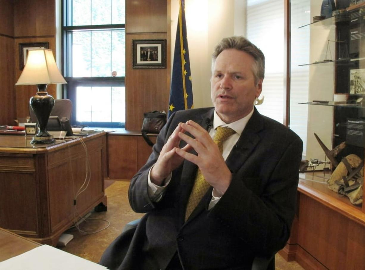 FILE - In this May 29, 2019 file photo, Alaska Gov. Mike Dunleavy speaks to reporters in his office at the state Capitol in Juneau, Alaska. Dunleavy said he hopes to move past the rancor of his first year in office, amid an unsettled dispute with lawmakers over state spending and threat of a recall effort looming large. The Republican will mark a full year in office Tuesday, Dec. 3.