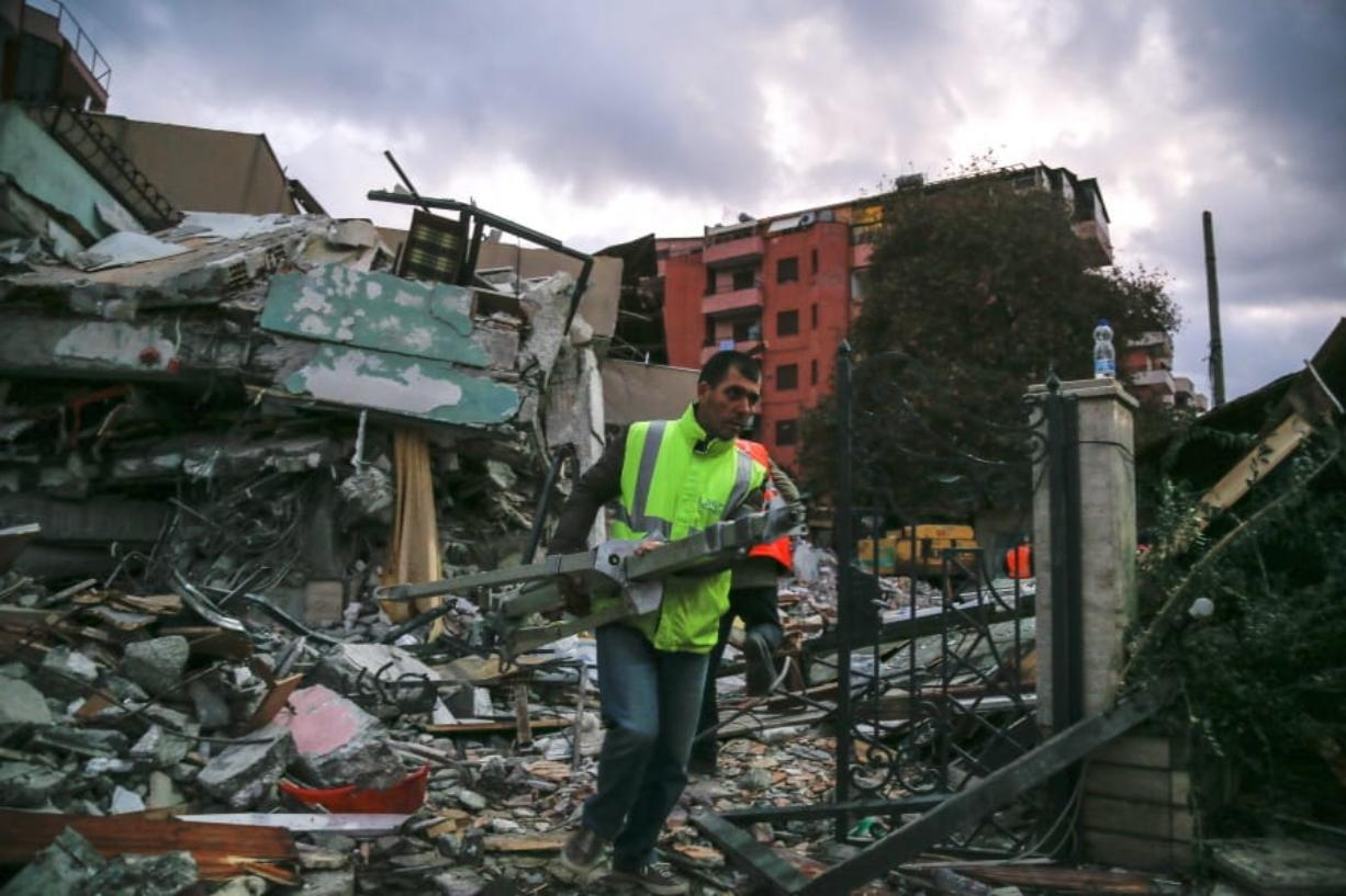 Image result for Rescuers comb rubble after earthquake in Turkey; 22 confirmed dead