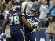 Seattle Seahawks wide receiver DK Metcalf, right, celebrates with D.J. Fluker (78) after scoring a touchdown against the Tampa Bay Buccaneers during the second half of an NFL football game, Sunday, Nov. 3, 2019, in Seattle.