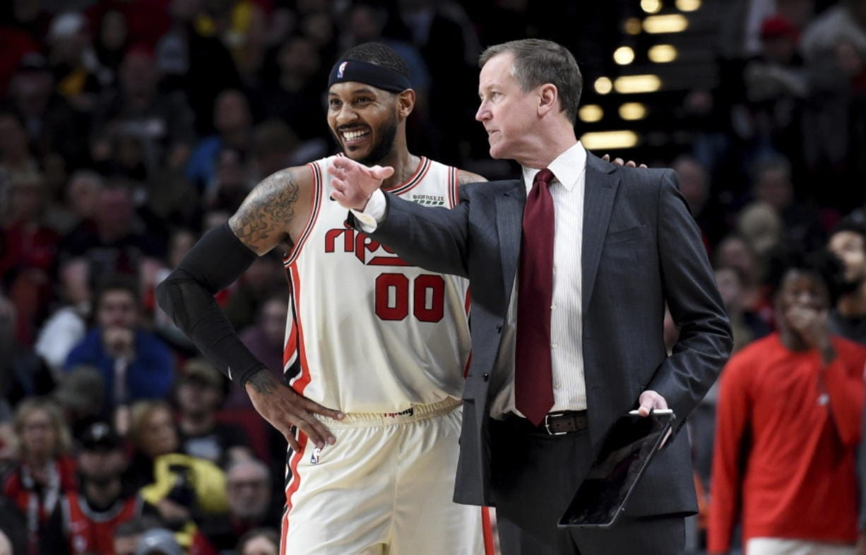 Portland Trail Blazers forward Carmelo Anthony, left, speaks with head coach Terry Stotts during the second half of an NBA basketball game against the Chicago Bulls in Portland, Ore., Friday, Nov. 29, 2019. The Blazers won 107-103. (AP Photo/Steve Dykes)