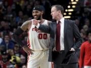 Portland Trail Blazers forward Carmelo Anthony, left, speaks with head coach Terry Stotts during the second half of an NBA basketball game against the Chicago Bulls in Portland, Ore., Friday, Nov. 29, 2019. The Blazers won 107-103.