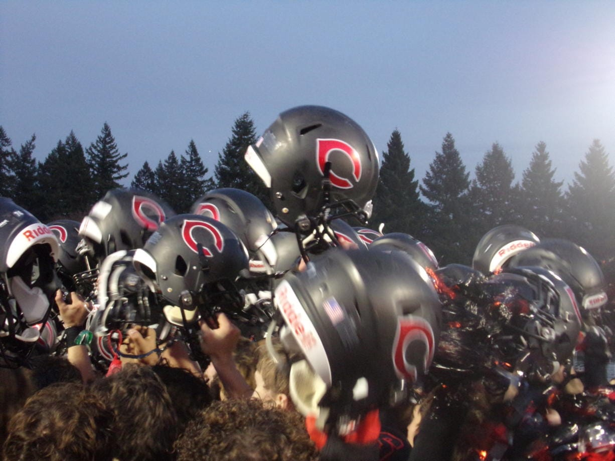 Camas players celebrate after their 56-27 win over Puyallup (Tim Martinez/The Columbian)