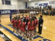 King's Way Christian players celebrate their five-set district semifinal win Wednesday over La Center.