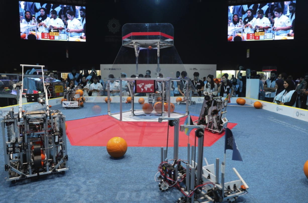 In this Friday, Oct. 25, 2019 photo, a team from Korea, on the right, competes with UAE Falcons during the First Global Challenge, a robotics and artificial intelligence competition in Dubai, United Arab Emirates. Seeking to bolster its image as a forward-looking metropolis, Dubai hosted the largest-ever international robotics contest this week, challenging young people from 190 countries to find solutions to global ocean pollution. (AP Photo/Kamran Jebreili)