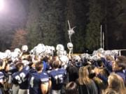 Skyview football players and students celebrate a 49-0 win over Federal Way in the 4A state preliminary round on Friday at Kiggins Bowl (Micah Rice/The Columbian)