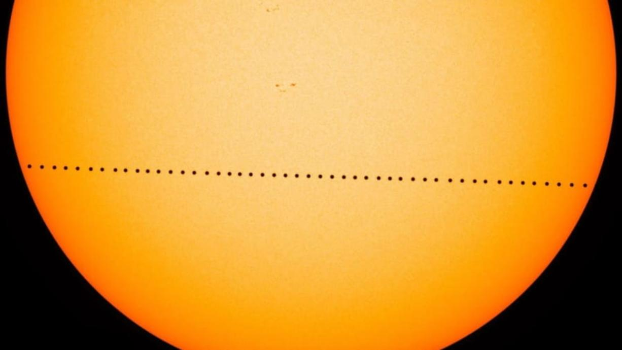 In this composite image, the planet Mercury is visible as it passes directly between the sun and Earth on May 9, 2016, in a transit which lasted 7 1/2  hours. On Monday morning, Mercury will make another transit.