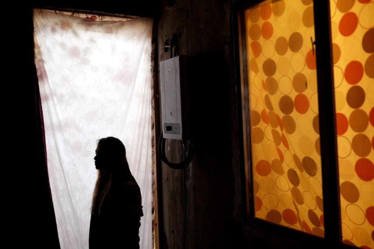 Lizbeth, a Salvadoran woman seeking asylum in the United States, poses for a portrait in a relative's home in Tijuana, Mexico. She never thought she would be returned to Mexico to wait for the outcome of her case after suffering multiple assaults and being kidnapped into prostitution on her journey through Mexico. (gregory bull/Associated Press)