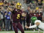 Arizona State quarterback Jayden Daniels (5) throws under pressure from Oregon linebacker Isaac Slade-Matautia during the second half of an NCAA college football game Saturday, Nov. 23, 2019, in Tempe, Ariz. Arizona State won 31-28.