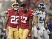 San Francisco 49ers wide receiver Emmanuel Sanders (17) yells next to running back Matt Breida (22) and Seattle Seahawks middle linebacker Bobby Wagner (54) during the first half of an NFL football game in Santa Clara, Calif., Monday, Nov. 11, 2019.