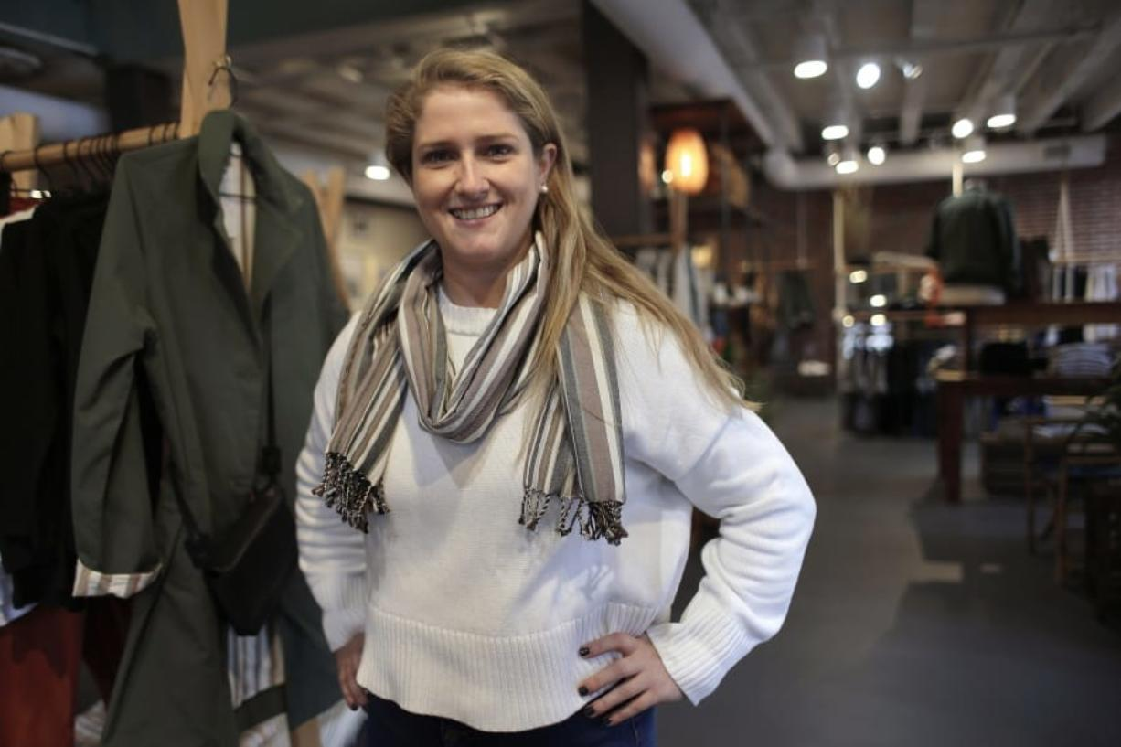 In this Thursday, Nov. 14, 2019, photo, Annie Venditti, vice president of operations at clothing retailer American Rhino, stands for a photograph in the store, in Faneuil Hall Marketplace, in Boston. At the age of 23, Venditti was learning about the complexities of building and liquor laws. The company did the smart thing, and got a consultant to guide them.