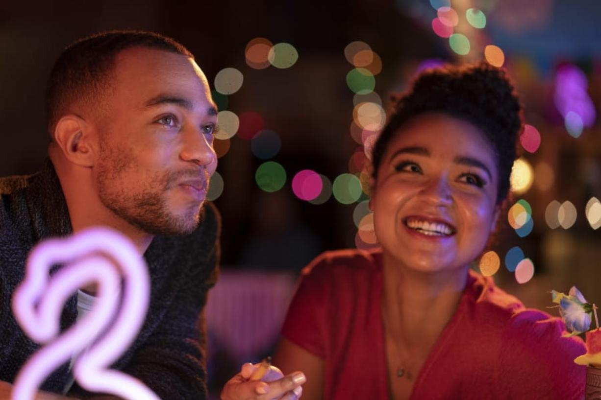 """Kendrick Sampson and Aisha Dee in a scene from """"Ghosting: The Spirit of Christmas,"""" airing Dec. 4 on Freeform. (David Bukach/Freeform)"""