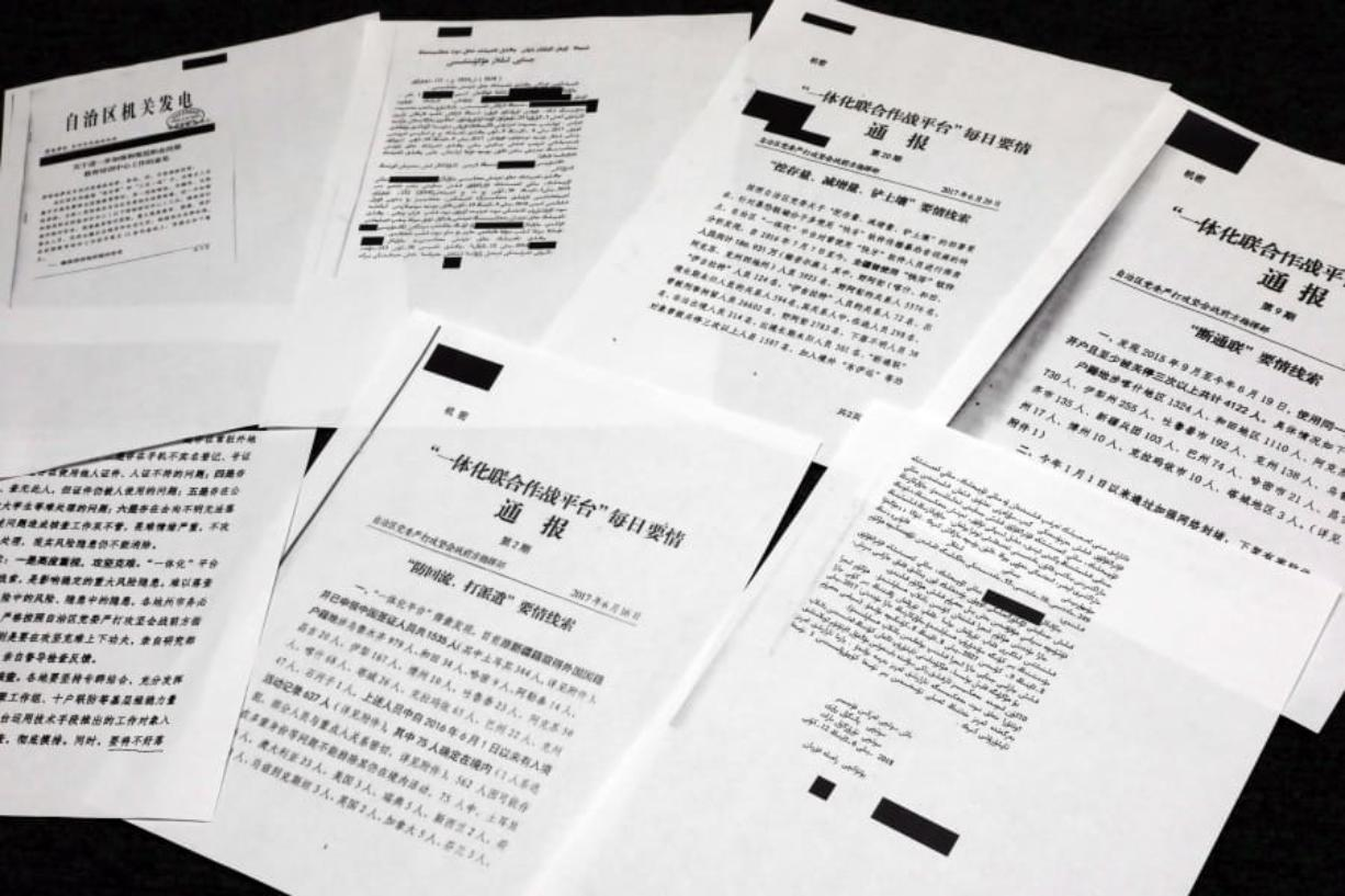 A sample of classified Chinese government documents leaked Friday to a consortium of news organizations, is displayed for a picture in New York,. Beijing has detained more than a million Uighurs, ethnic Kazakhs and other Muslim minorities for what it calls voluntary job training.