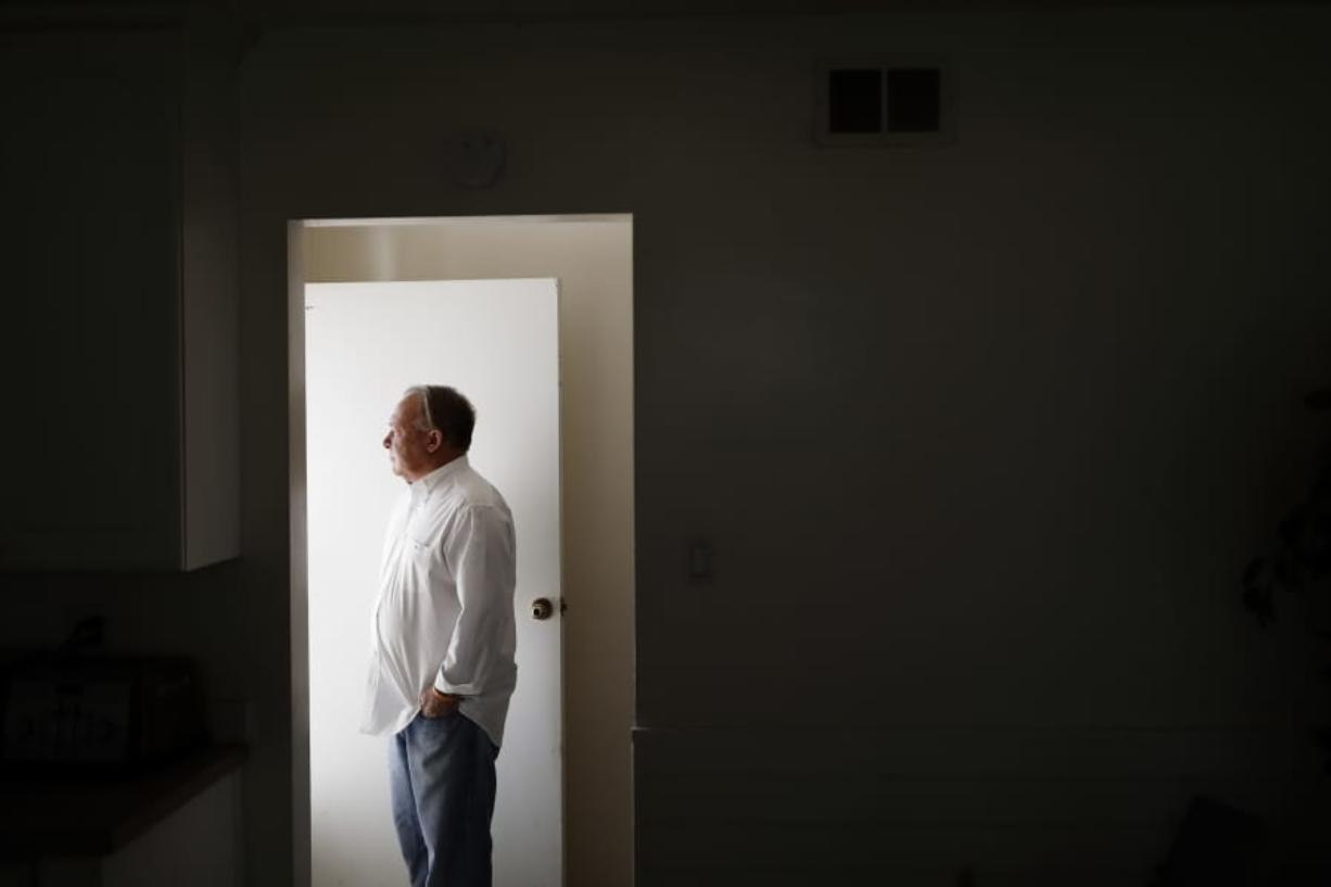 David Lasher stands for a portrait at his home in Carlsbad, Calif., on Friday, Oct. 4, 2019. When Lasher reported sexual abuse by a priest to an independent review board, the board ruled against him. (AP Photo/Gregory Bull)