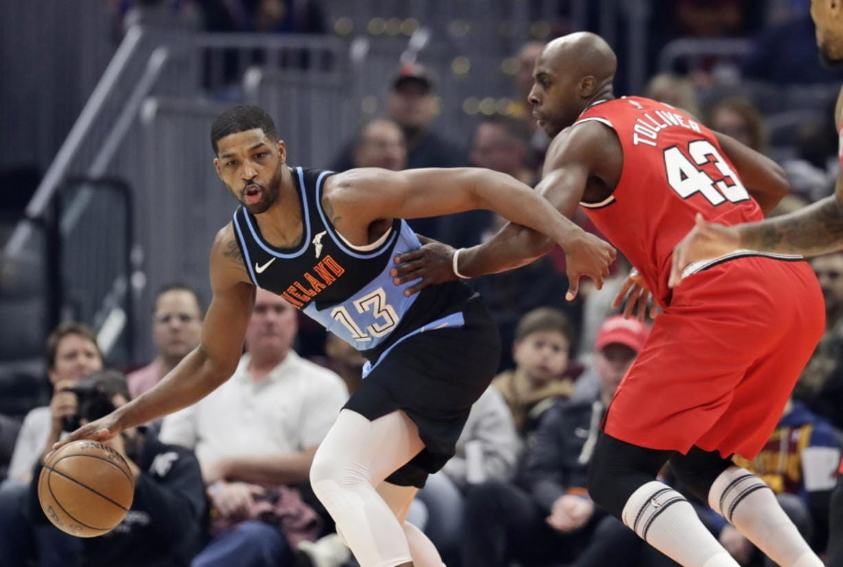 Cleveland Cavaliers' Tristan Thompson (13) drives past Portland Trail Blazers' Anthony Tolliver (43) in the first half of an NBA basketball game, Saturday, Nov. 23, 2019, in Cleveland. (AP Photo/Tony Dejak)