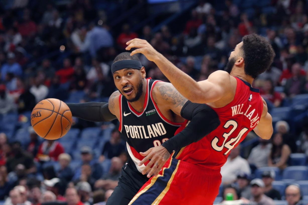 Portland Trail Blazers forward Carmelo Anthony is defended by New Orleans Pelicans guard Kenrich Williams (34) during the second half of an NBA basketball game in New Orleans, Tuesday, Nov. 19, 2019. The Pelicans won 115-104.